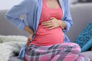 Щекотание в животе во время беременности